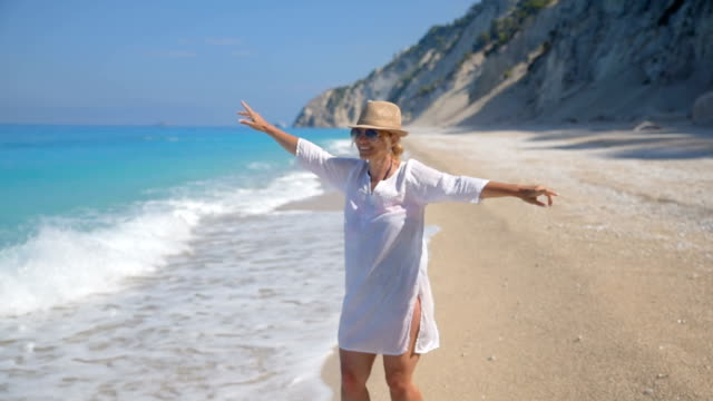 woman enjoying at the beach - greece stock videos & royalty-free footage