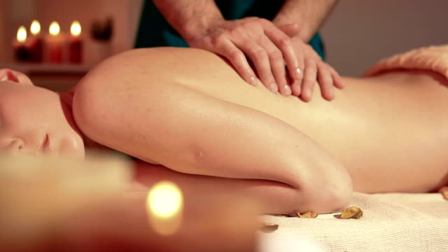 Woman enjoying back massage dolly shot