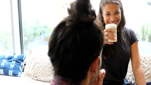 woman enjoying coffee with friend in cafe - 20 29 years stock videos & royalty-free footage