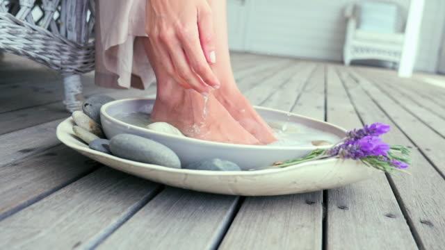 Woman enjoying foot bath