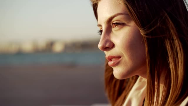 woman enjoying fresh air by the sea - eyes closed stock videos & royalty-free footage