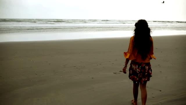 Woman enjoying fresh near Morjim coastline, Goa