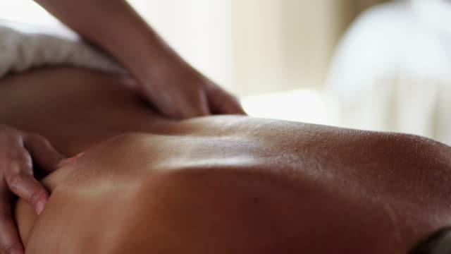 woman enjoying her massage in spa - rear view stock videos & royalty-free footage