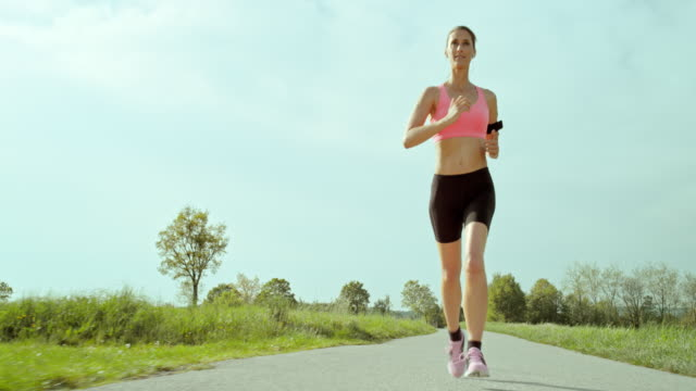 slo mo ts woman enjoying her run - front view stock videos & royalty-free footage