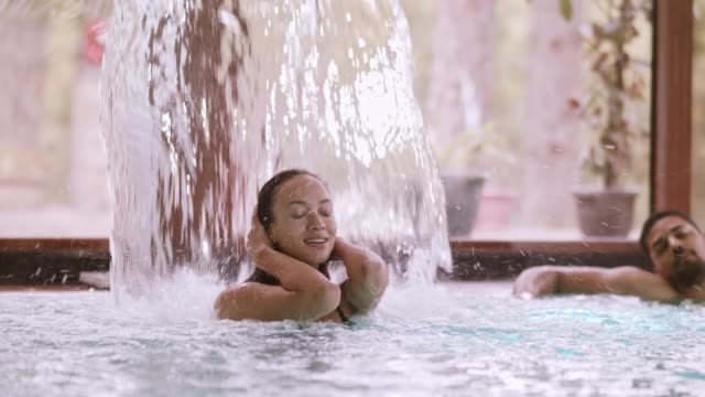 woman enjoying hydrotherapy treatment - hydrotherapy stock videos & royalty-free footage