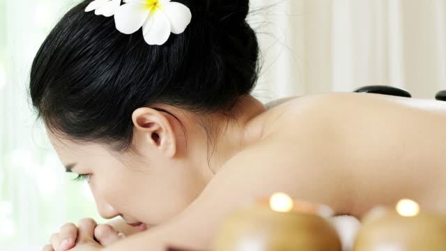 Woman enjoying massage for relaxation.