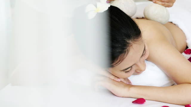 woman enjoying massage for relaxation. - afc women's asian cup stock videos and b-roll footage