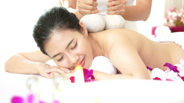 woman enjoying massage for relaxation. - lastone therapy stock videos and b-roll footage