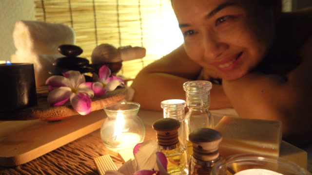 4k: woman enjoying massage - lastone therapy stock videos and b-roll footage