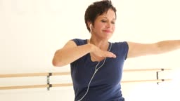 Woman enjoying music and practicing dance in class
