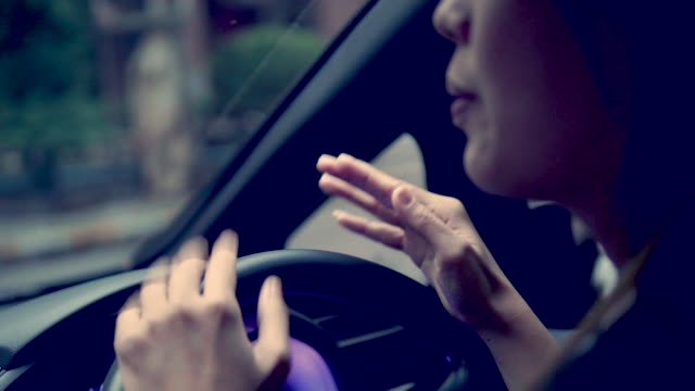 woman enjoying music in car - listening stock videos & royalty-free footage