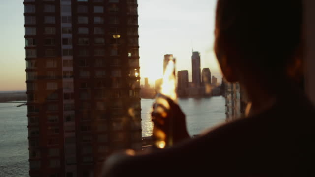 woman enjoying new york at the window - drink stock videos & royalty-free footage