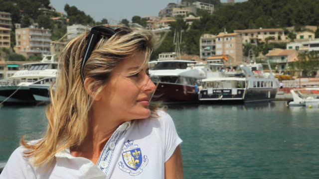 MS DS Woman enjoying ride on motorboat / Palma de Mallorca, Mallorca, Baleares, Spain