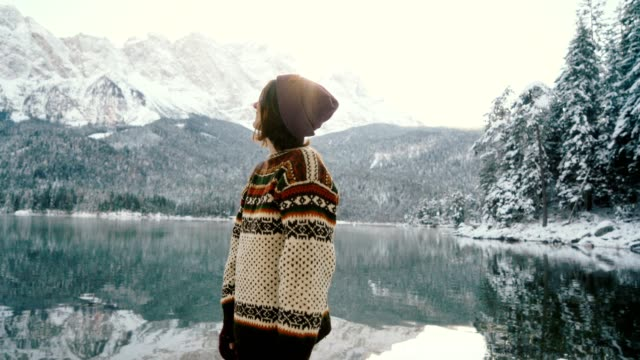 woman enjoying scenic view of eibsee lake in alps - pullover stock videos & royalty-free footage