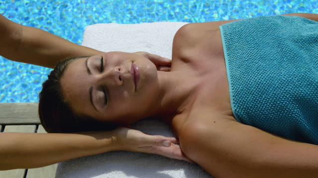 woman enjoying spa treatment - spa treatment stock videos and b-roll footage