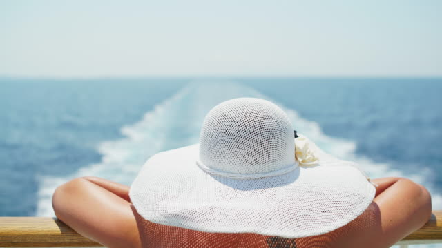 woman enjoying summer breeze on the cruise ship - hat stock videos and b-roll footage