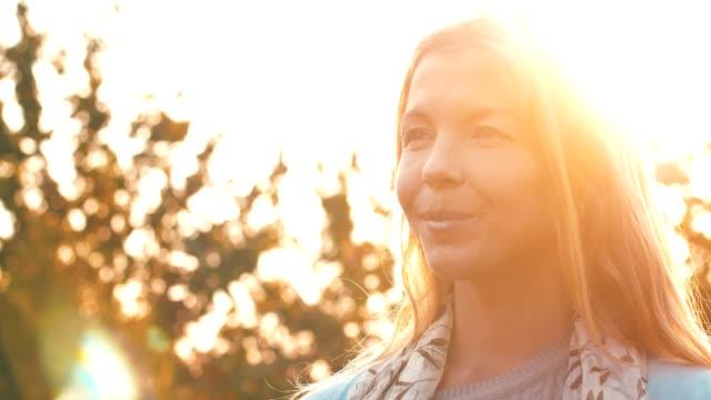 woman enjoying sunny day - back lit stock videos & royalty-free footage