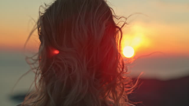 super slo mo woman enjoying the amazing seaview and the beautiful sunset - super slow motion stock videos & royalty-free footage