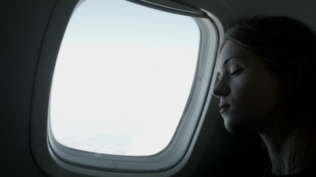 woman enjoying the flight - sleeping stock videos & royalty-free footage