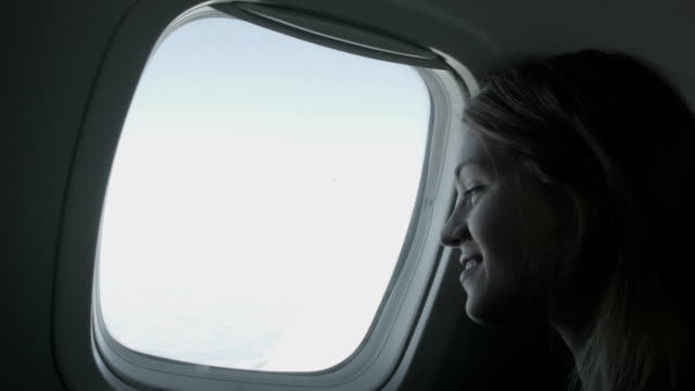woman enjoying the flight - business travel stock videos & royalty-free footage