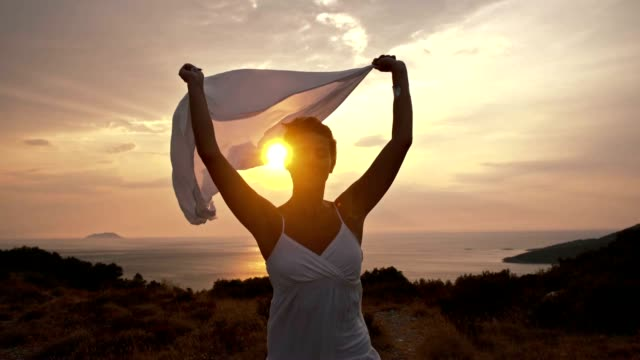 slo mo woman enjoying the freedom and summer breeze - scarf stock videos & royalty-free footage