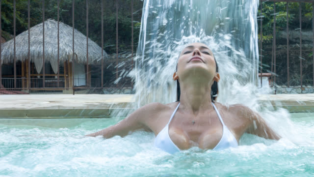 Woman enjoying the hydrotherapy at the spa
