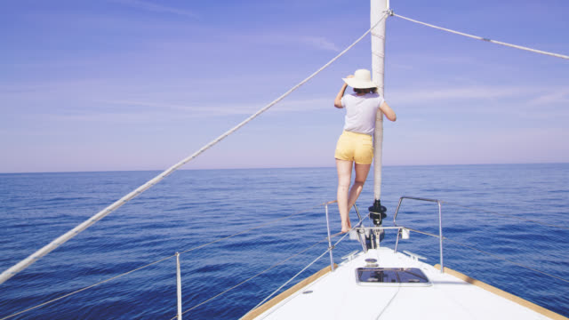 ws woman enjoying the sailing on a sailboat's bow - ship's bow stock videos & royalty-free footage