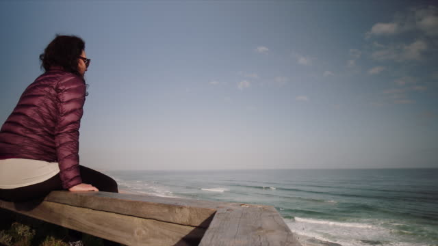 A woman enjoying the sea views at Mornington Peninsula, Victoria, Australia