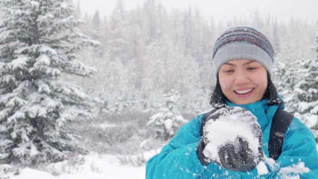 Woman enjoying the snowfall