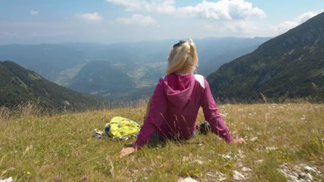 slo mo woman enjoying the view on the mountain - slovenia stock videos & royalty-free footage