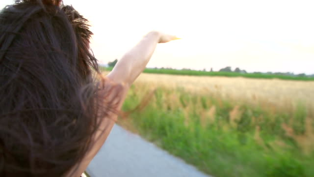 HD SUPER SLOW-MOTION: Woman Enjoying The Wind In Convertible