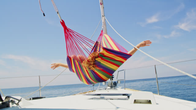 ws woman enjoying the wind on a sailboat - patio stock videos & royalty-free footage