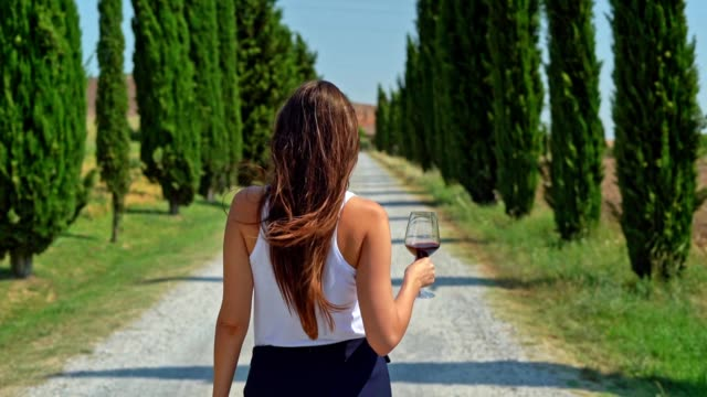 woman enjoying tuscany in a cypress alley - tuscany stock videos & royalty-free footage
