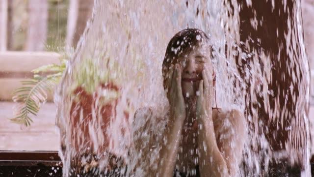 woman enjoying waterfall massage at health spa - spa treatment stock videos and b-roll footage