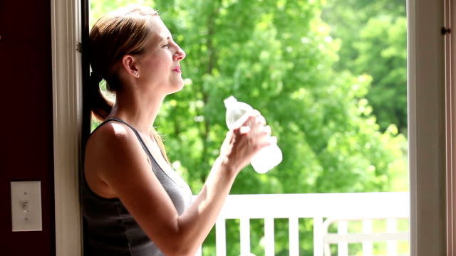 woman enjoying weather and bottle of water - ponytail stock videos & royalty-free footage