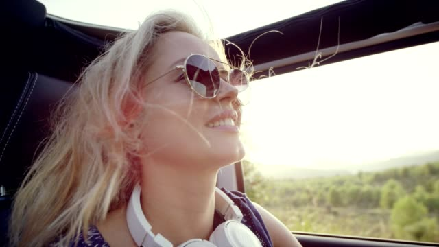 woman enjoying wind in her hair. riding suv without roof - auto convertibile video stock e b–roll
