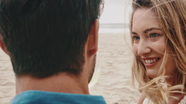 woman enjoying wine with boyfriend at beach - white wine stock videos & royalty-free footage
