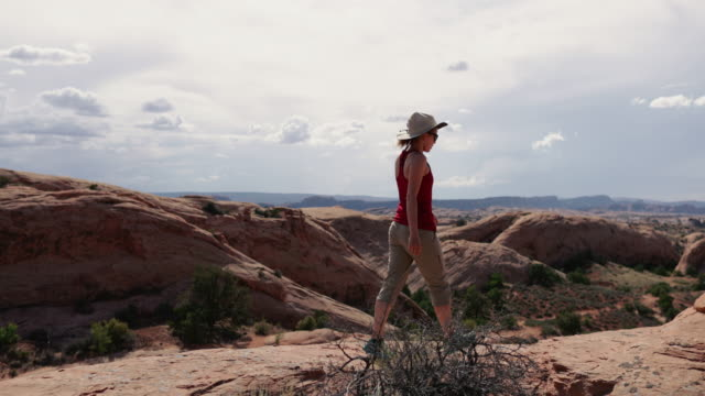 woman enjoys nature in the southwest usa, moab - moab utah stock videos & royalty-free footage