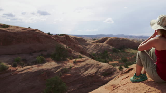 woman enjoys nature in the southwest usa, moab - utah stock videos & royalty-free footage