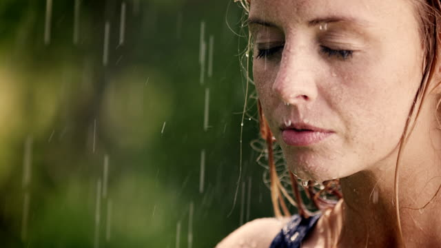 woman enjoys summer rain on her face - beauty in nature stock videos & royalty-free footage