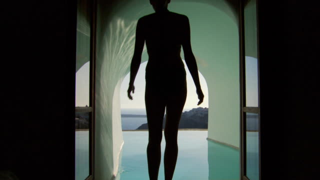 a woman entering a luxurious pool - see other clips from this shoot 1144 stock videos & royalty-free footage