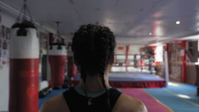 woman entering boxing ring - entering stock videos & royalty-free footage
