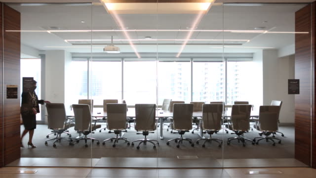 woman entering empty conference room at jll office in dallas, texas, u.s., on wednesday, september 9 - board room stock videos & royalty-free footage