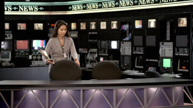 ms woman entering newsroom set and laying down scripts, dallas, texas, usa - press conference stock videos and b-roll footage