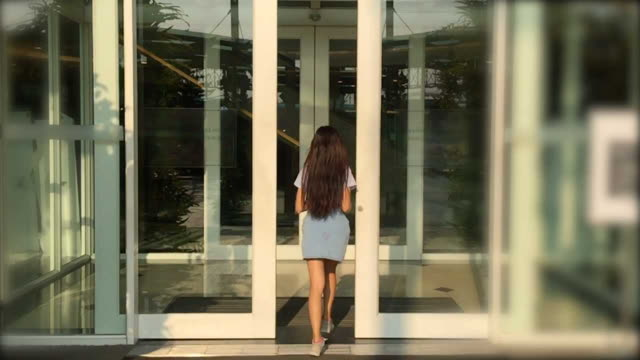 woman entering the shopping mall  door - entering stock videos & royalty-free footage