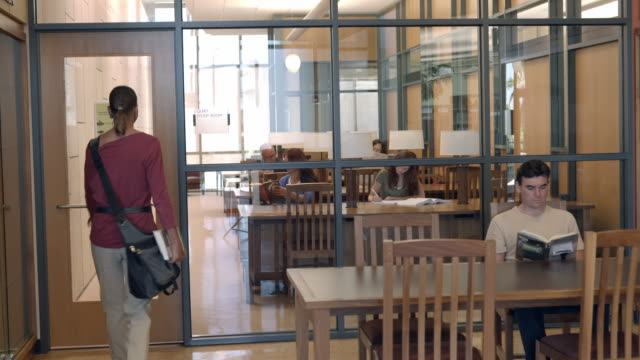 ws ts woman enters quiet study room in modern public library / rancho mirage, california, usa - rancho mirage stock videos & royalty-free footage
