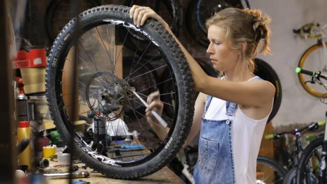 woman entrepreneur - repair shop stock videos & royalty-free footage