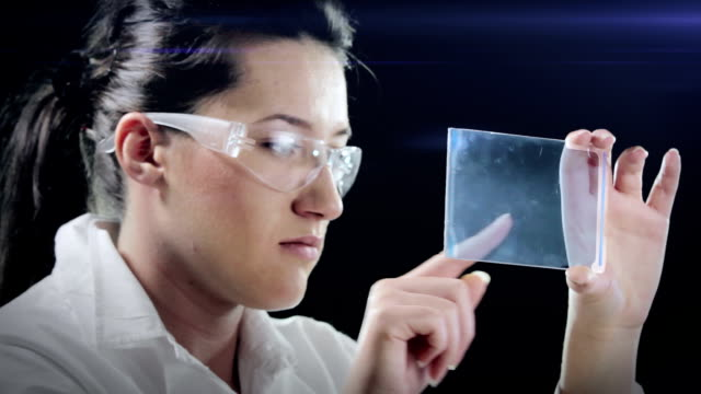 woman examines sample demo - replication bubble stock videos and b-roll footage