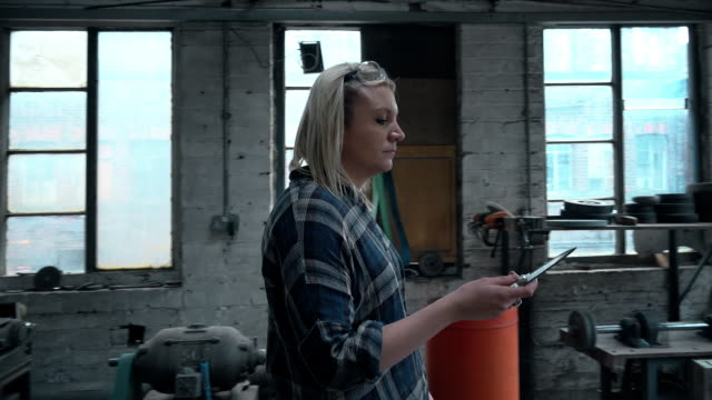 woman examining knife - genderblend stock videos & royalty-free footage