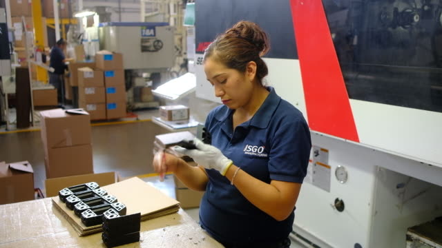 woman examining parts in isgo manufacturing factory, on monday, july 8, 2019. - machine part stock videos & royalty-free footage